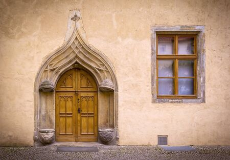 16th century: Detail of an old, historical Facade with typical stone seats from the 16th century in the medieval town Wittenberg, Germany, late gothic style. Stock Photo