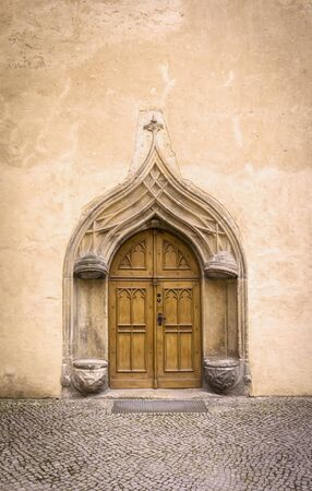 gothic style: Detail of an old, historical Facade with typical stone seats from the 16th century in the medieval town Wittenberg, Germany, late gothic style. Stock Photo