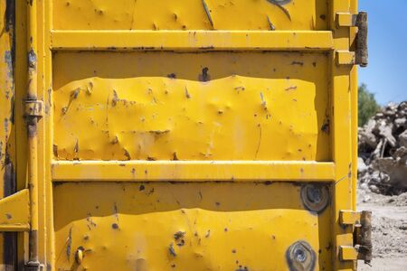 metal scrap: Big yellow container with metal scrap. Stock Photo