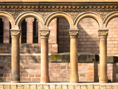 terra cotta: Columns in a row with terra cotta ornates, seen at a church from the early 19th century, built in the antique style. Stock Photo