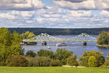 cold war: View to Glienicke Bridge, the Bridge of Spies. Glienicke Bridge is the bridge which spans the Havel River to connect the cities of Berlin and Potsdam. It was the bridge to exchange captured spies during the Cold War. The Bridge is also a symbol of German