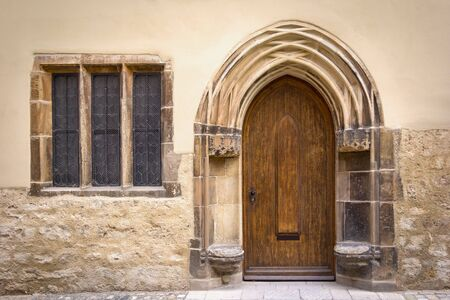 gothic style: Detail of an old, historical Facade with typical stone seats from the 16th century in the medieval town Naumburg, Germany, late gothic style. Stock Photo