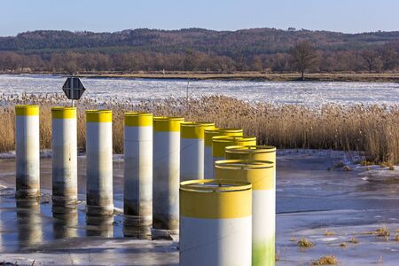ice floes: Metal barrier against ice floes at the River Oder, the border between Germany and poland near the town Schwedt. Stock Photo