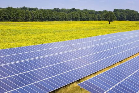 View of a solar energy station on a field in Brandenburg. In Brandenburg, there is already a very high share of renewable energies such as wind and sun. Stock Photo