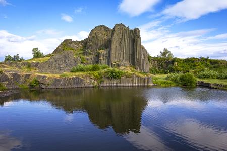 Interesting polygonal structures of basalt columns, also named Herrnhausfelsen, natural monument Panska skala near NovyBor (Czech Republic). Basalt is a extrusive volcanic rock formed from the rapid cooling of basaltic lava.