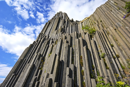 Interesting polygonal structures of basalt columns, also named Herrnhausfelsen, natural monument Panska skala near NovyBor (Czech Republic). Basalt is a extrusive volcanic rock formed from the rapid cooling of basaltic lava.