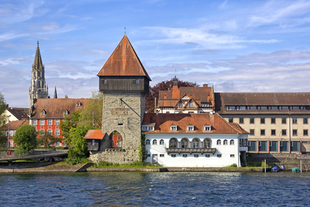 View to the Rheintorturm, a section of the former city wall of Konstanz at Lake Constance. Konstanz is a university city with 80,000 inhabitants, bordering Switzerland. The Rhine river, which starts in the Swiss Alps, passes through Lake Constance and lea
