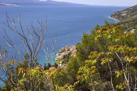 Overlooking a small village on the Adriatic coast, near Split, in Damlmatien, Croatia. 写真素材