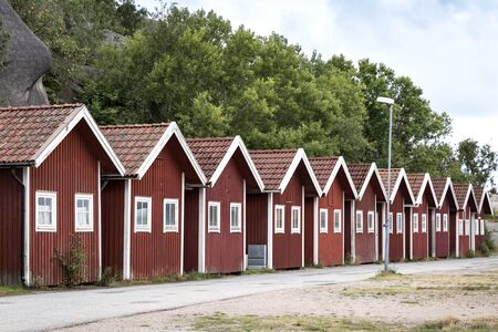 Close to the Swedish skerry archipelago in the province of Bohuslan, these traditional boathouses are located in a small harbor. Everything is stored there for fishing or they are rented as a holiday cottage.