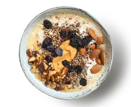 A delicious bowl as a wholesome, healthy meal with nuts and dried fruit.