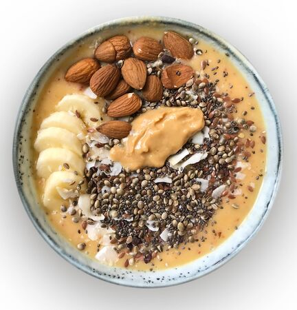 A delicious bowl as a wholesome, healthy meal with nuts, seeds and banana slices. Zdjęcie Seryjne