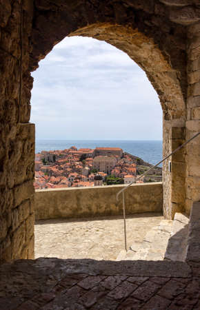 View from the fortress Dubrovnik on parts of the medieval city. One can walk around on the ramparts the city. This make a lot of tourists. This one has many interesting views on the roofs of old houses and churches with cupolas. Editorial