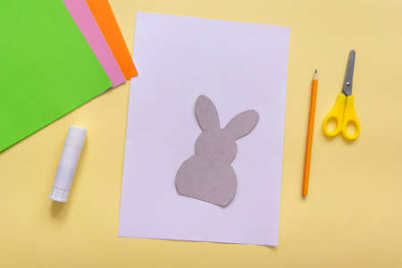Step by step photo instruction How to make Origami paper bunny with carrot for Easter greetings card. Children's art project. DIY concept. Step1