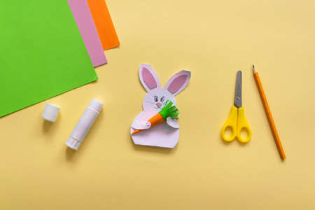 Step by step photo instruction How to make Origami paper bunny with carrot for Easter greetings card. Children's art project. DIY concept. Step 20 finished work