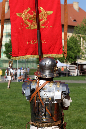 Roman soldier carrying a flag Editorial
