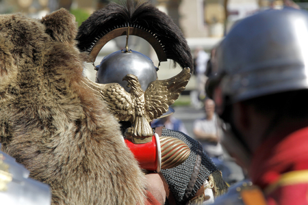 Roman aquila carried by troops aligned for battle, back view
