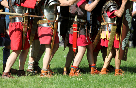Feet of Roman soldiers marching to battle