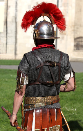 Reenactment of a Roman soldier with helmet and armor, back view