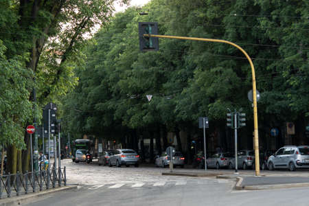 Milan, Italy - May 4, 2020: More cars were seen on the road. On May 4th Italy eases coronavirus movement restrictions after two month lockdown, phase 2. No traffic, almost empty streets