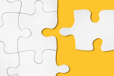 Unfinished white jigsaw puzzle. Perfect match idea. Successful decision, solution of problem. Business teamwork, partnership concept. Last missing detail of project. Cooperation in crisis time.