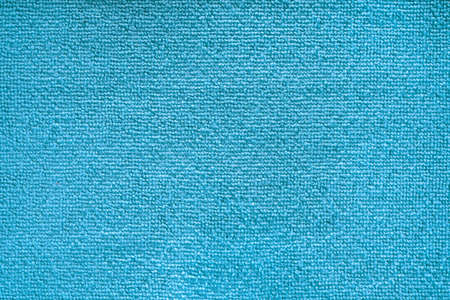 Cleaning microfiber pattern. Blue polyester microfibre texture. Synthetic fiber material Cleaning cloth for dust or kitchen top view closeup
