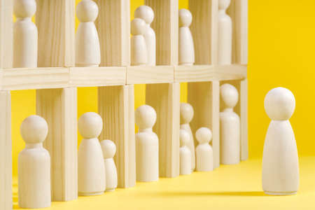 Isolation at home concept with wooden figurines.