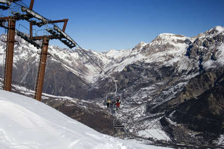 ski-lift on a blue sky and big mountain (France)