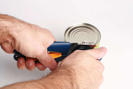 can opener: Singlee man opening a can with can opener