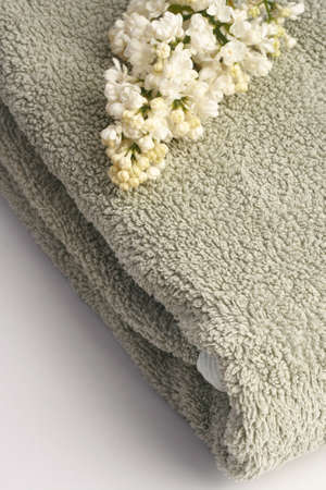 White syringa on the grey turkey towel.