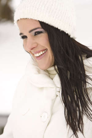 Portrait of beautiful young woman with snow in winter Stock Photo