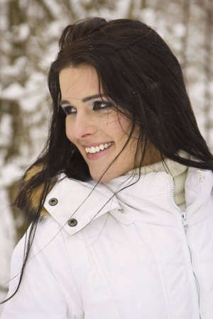 fur hood: Portraitof beautiful young woman with snow in winter