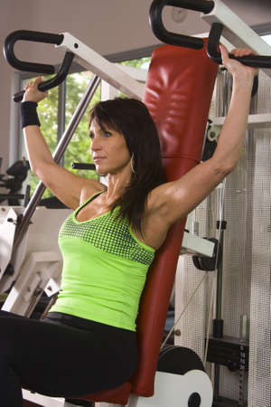 Woman is doing exercises in a fitness room  gym Stock Photo