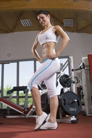 young fitness girl posing in the gym Stock Photo