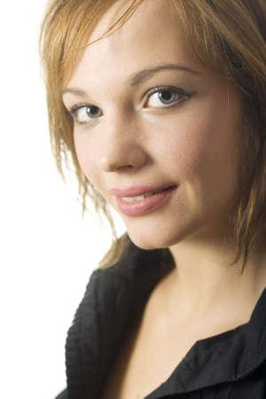 gingerish: Blue eyed young girl portrait in black blouse. Stock Photo