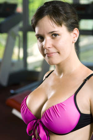 young fitness girl posing at the gym