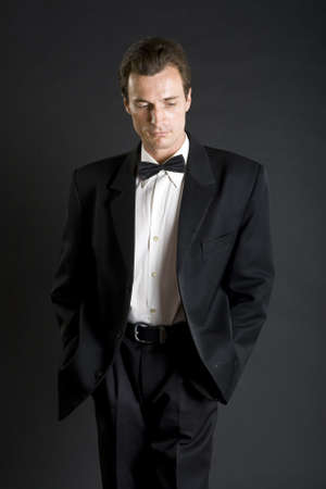 dinner jacket: Man in black dinner jacket with bow tie