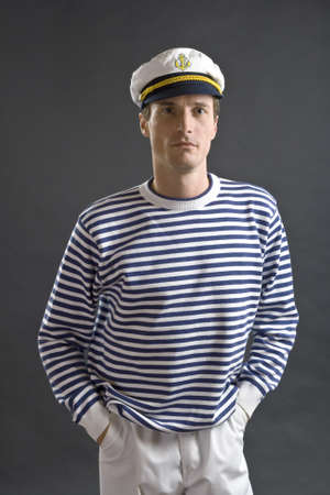 sailor hat: Young sailor man with white sailor hat