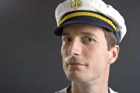 Young sailor man with white sailor hat photo
