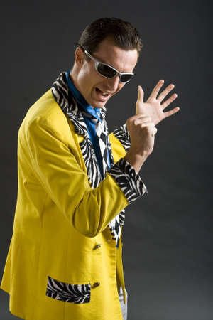 showman: retro style rockabilly singer from 1950s in yellow jacket