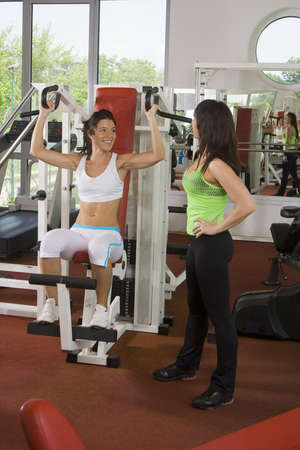 young girl and her coatch are doing exercises in a fitness room  gym Stock Photo