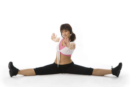 Middle aged woman doing stretching exercises on the foor