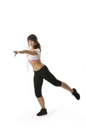 an attractive middle aged woman in sportswear is dancing