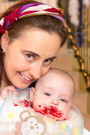 snotty: Mother feeding her snotty half year old son Stock Photo