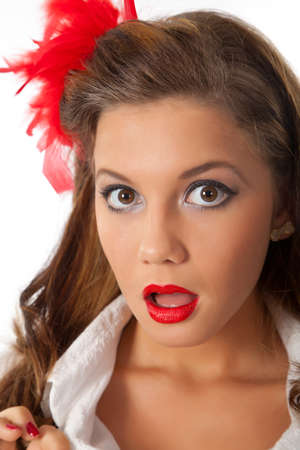 surprised pin-up teenage girl with red feather in her hair