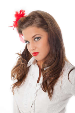 scornful pin-up teenage girl with red feather in her hair