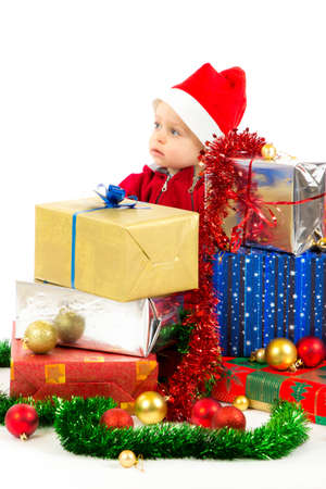 Santa helper baby with christmas gifts width white background Stock Photo - 16472564