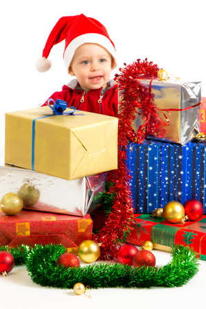 Santa helper baby with christmas gifts width white background Stock Photo - 16472568
