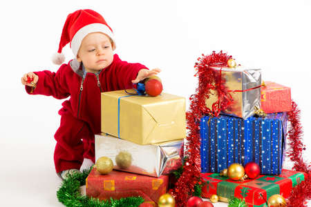 Santa helper baby with christmas gifts width white background Stock Photo