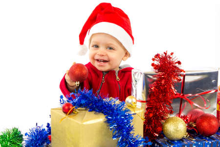 Santa s little helper baby with christmas gifts with white background Stock Photo - 16638882