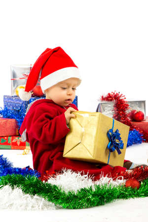 santa s helper: Santa s little helper baby with christmas gifts with white background Stock Photo